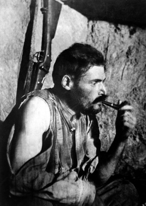 French_soldier_with_pipe_resting_after_World_War_I_battle.JPEG